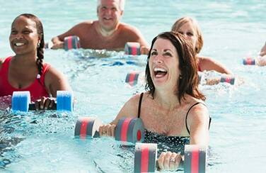 42803_Active adults doing water aerobics