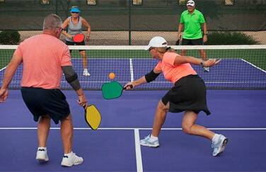 42759_Active adults playing pickleball