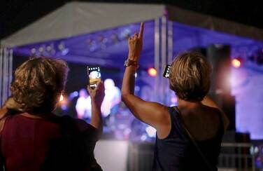 7 58630_Older Women at Country Music COncert GettyImages-1031557340