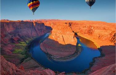 3 805 x 453 58611_Hot Air Balloons over Colorado River GettyImages-506224688