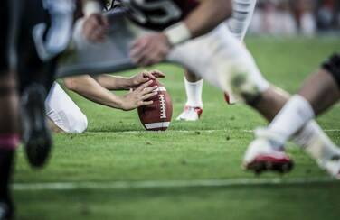 7 805 x 453 58608_Football Play GettyImages-162500554