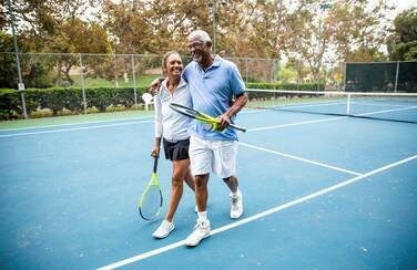 12 501 x 624 57349_Couple Playing Tennis