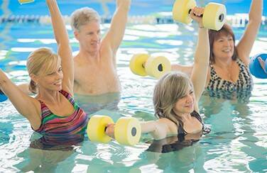 57345_group of people doing water aerobics