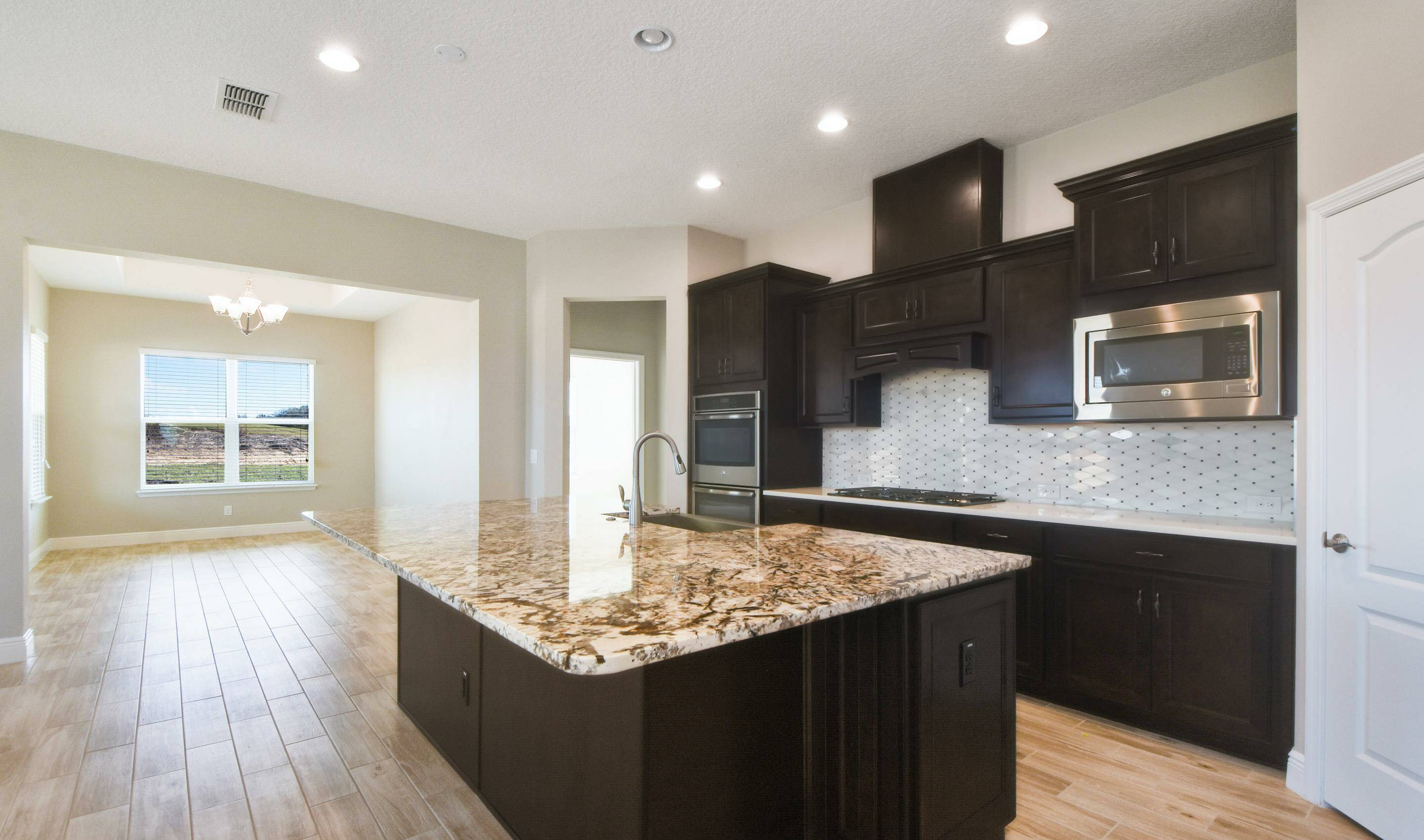 island kitchen in the Barbados in Four Seasons at Orlando  new homes in Orlando Florida
