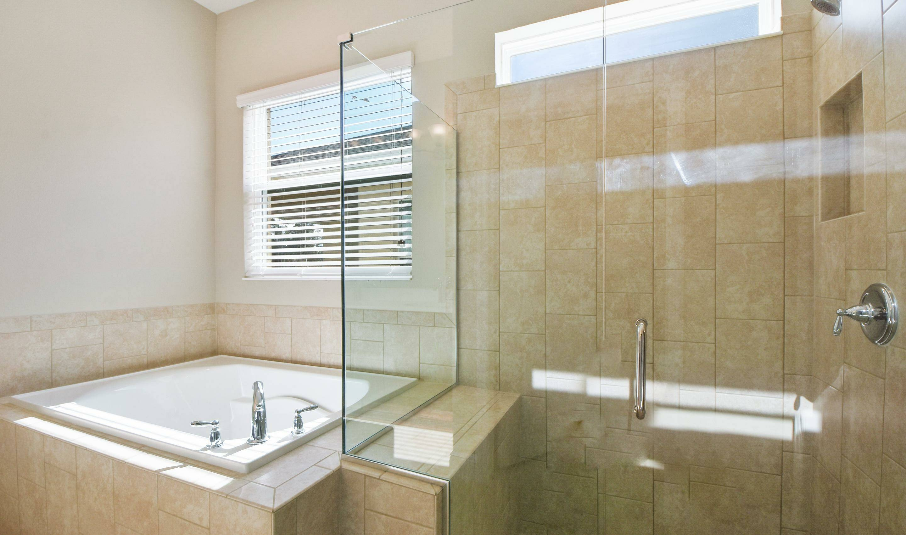 spacious luxury owners bath in the Barbados in Four Season at Orlando new homes in Orlando Florida