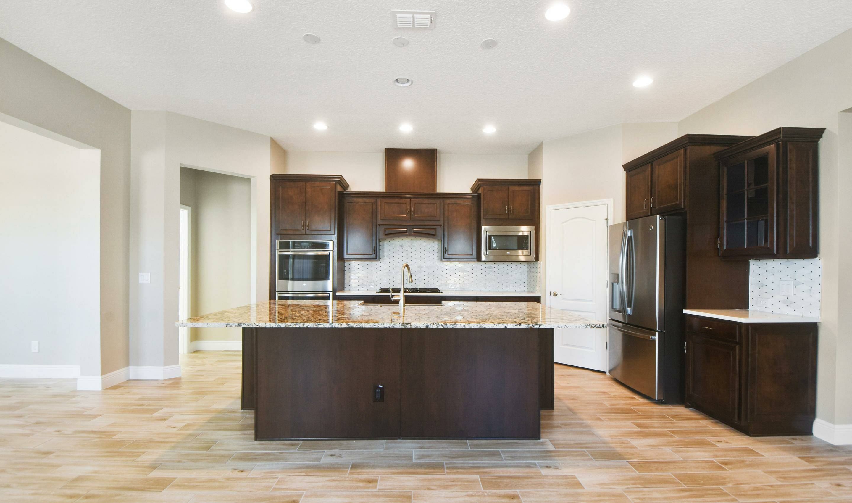 staggered kitchen in the Barbados in Four Seasons at Orlando new homes in Orlando Florida