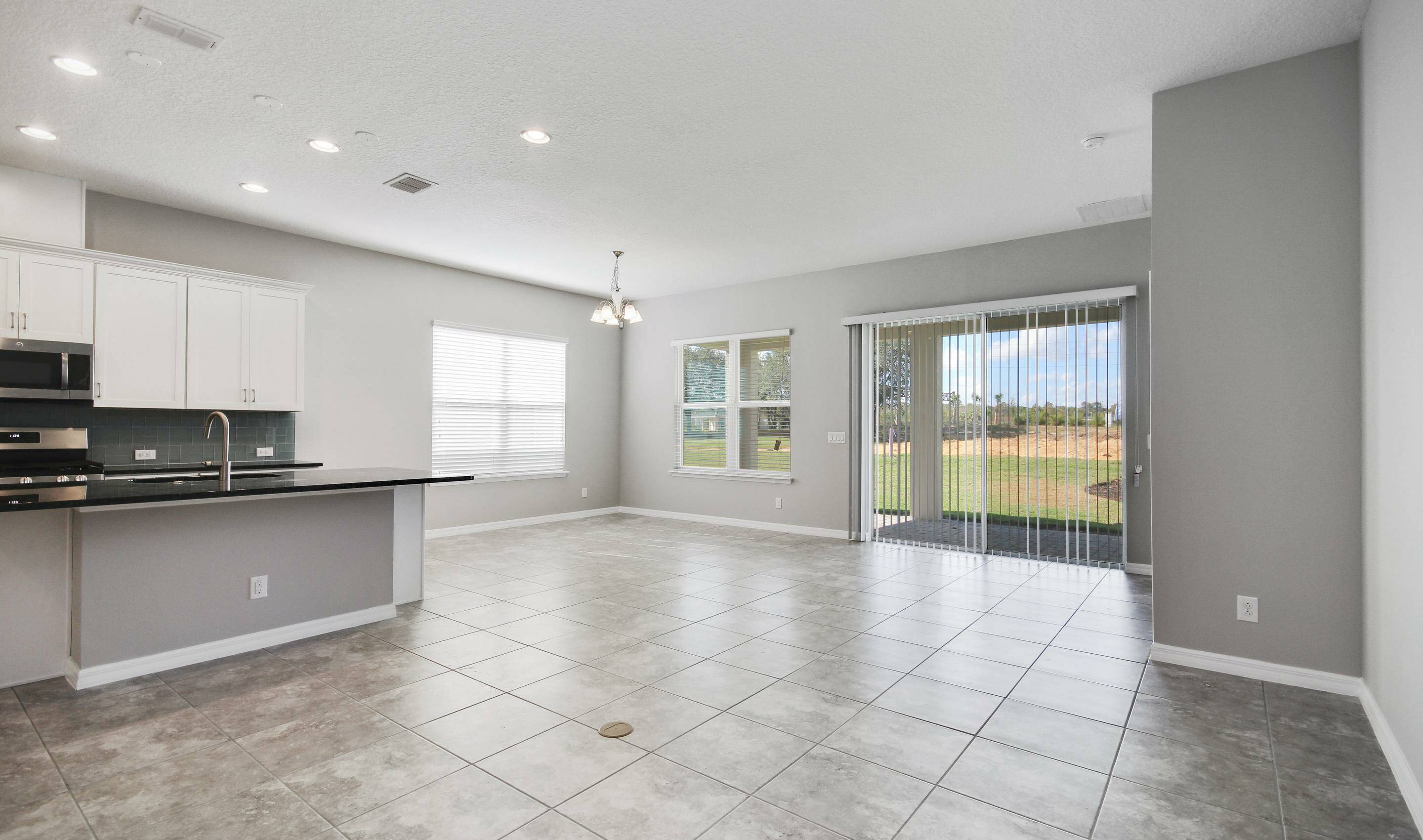 extended great room in the Bermuda in Four Seasons at Orlando new homes in Orlando Florida