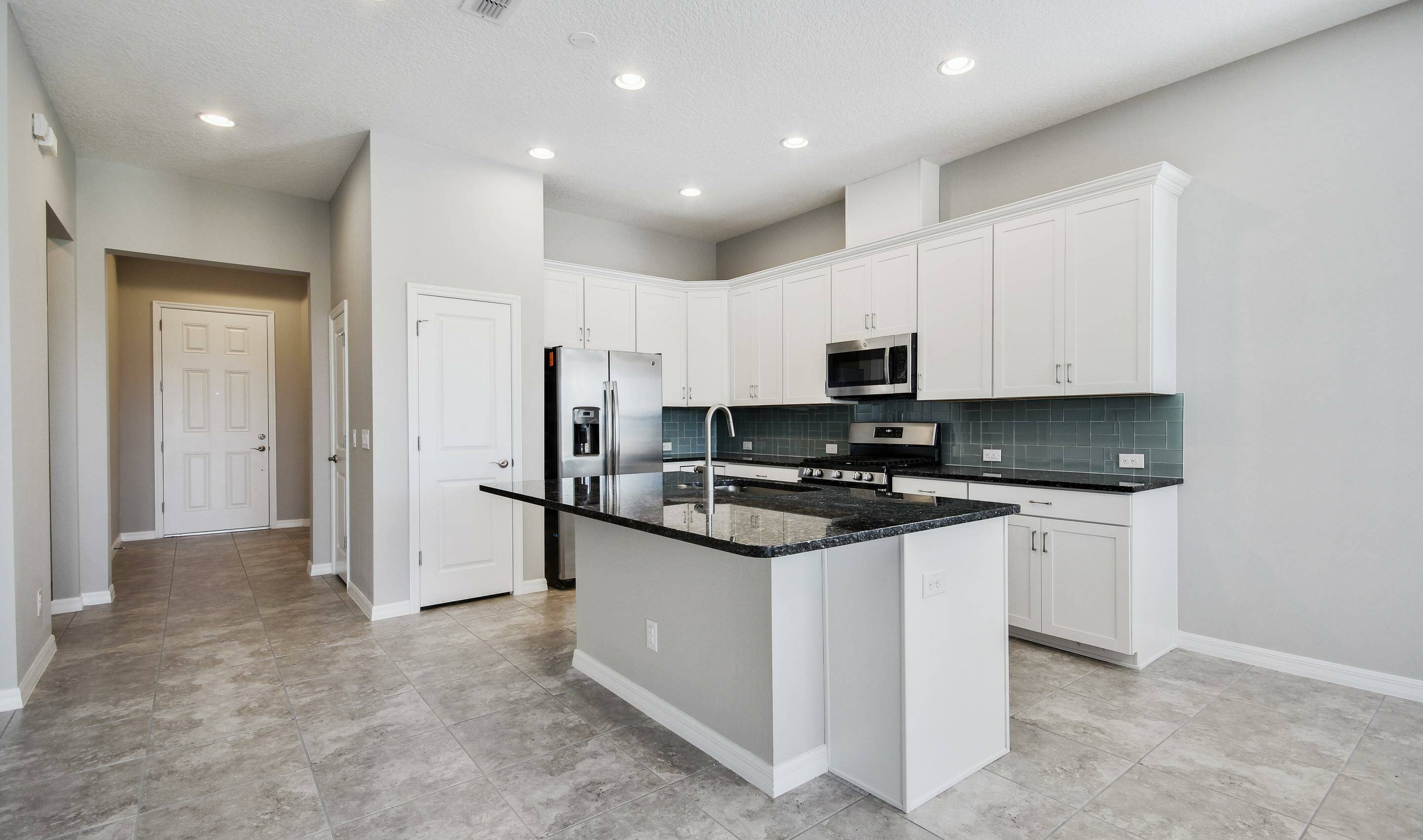 large center island in kitchen in the Bermuda in Four Seasons at Orlando new homes in Orlando Florida
