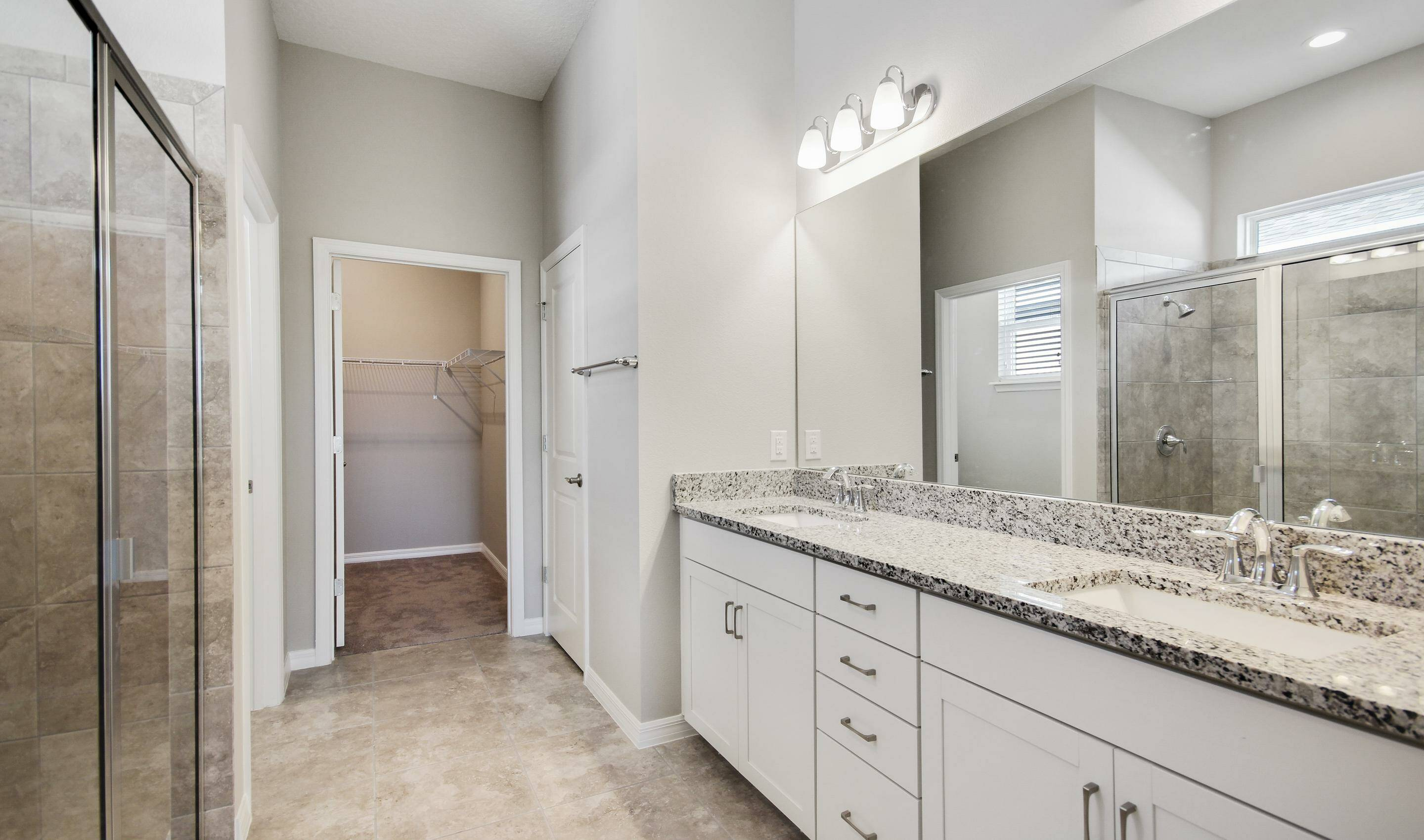 owners spa bath in the Bermuda in Four Seasons at Orlando new homes in Orlando Florida