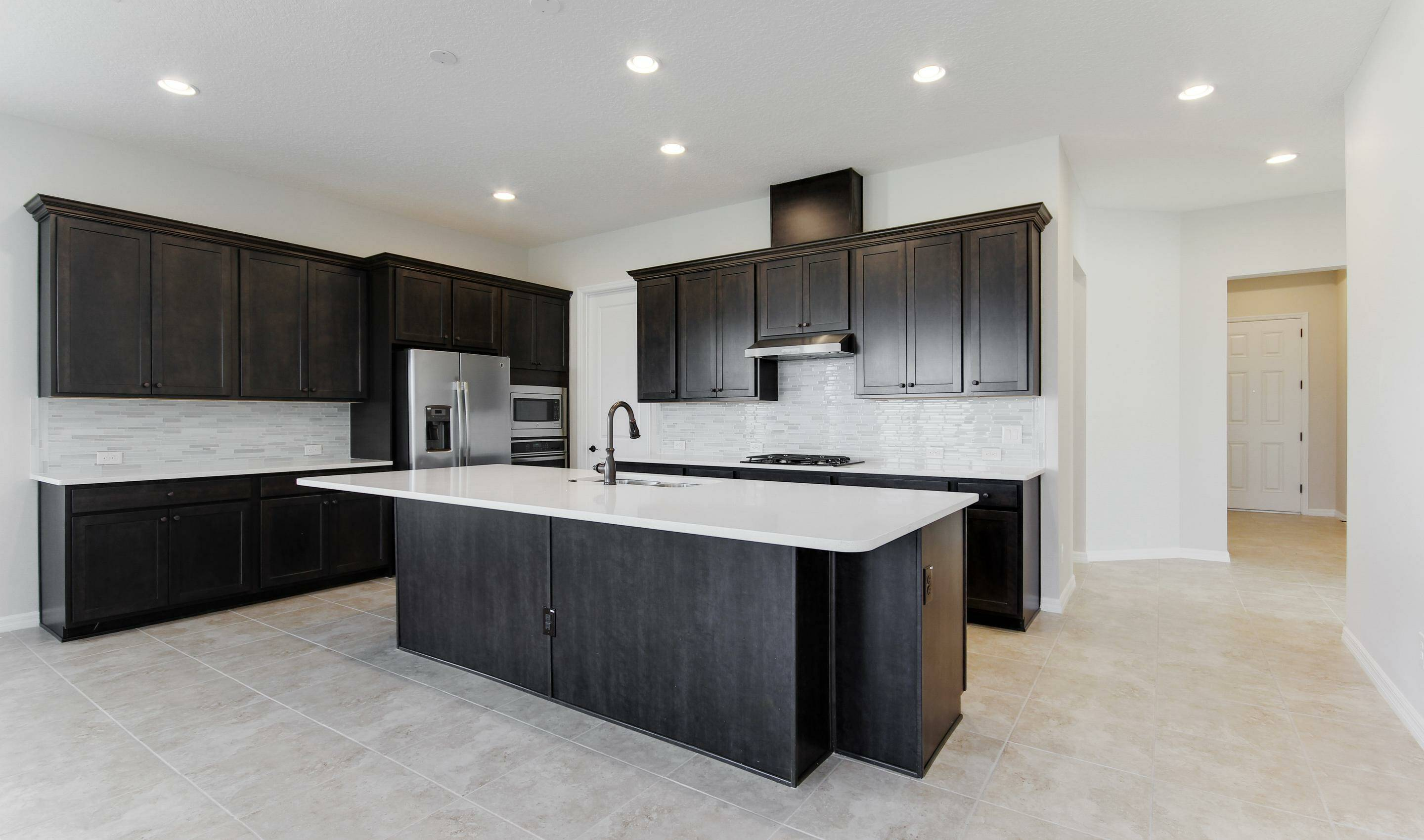 modern kitchen in dunmore in four seasons at orlando new homes in orlando florida