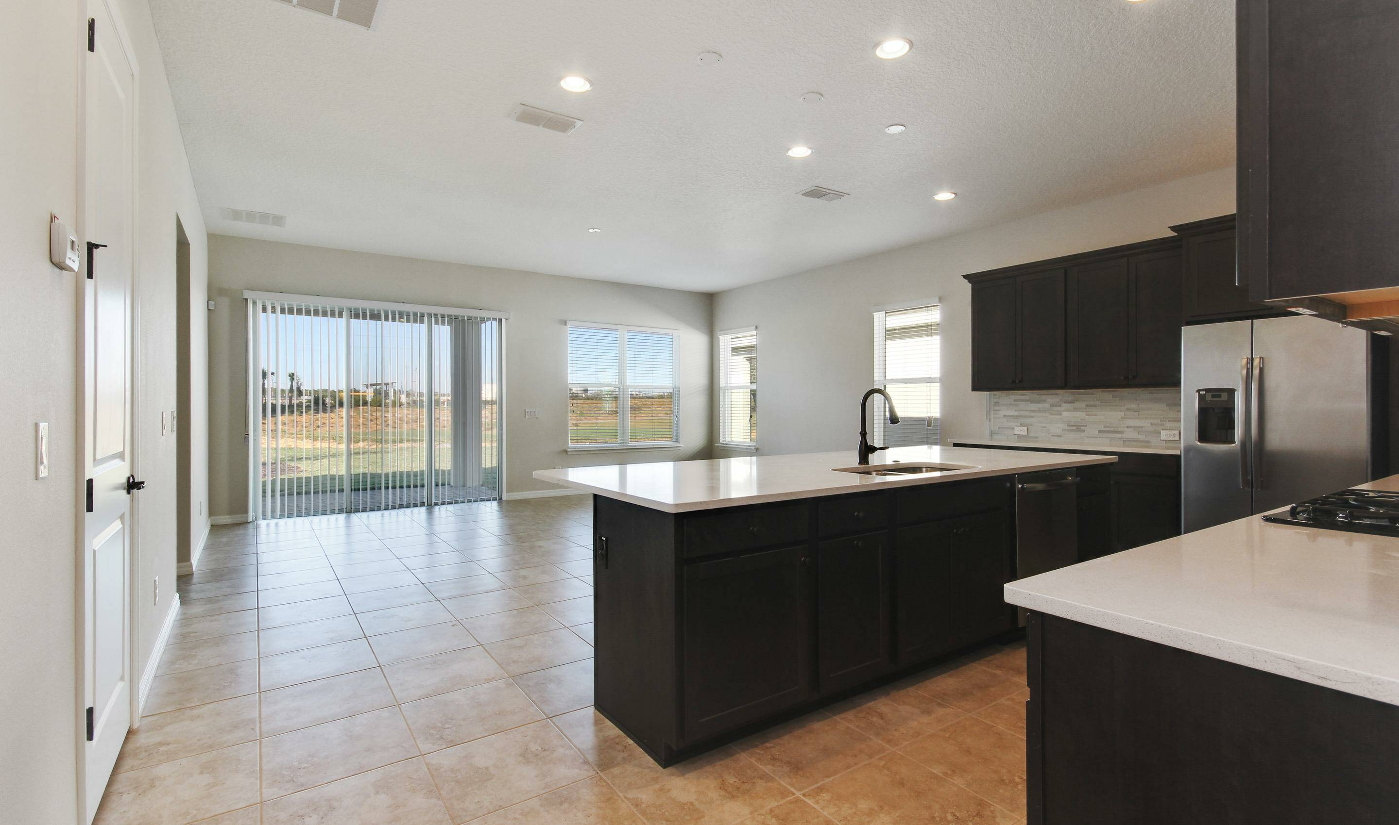 open flow kitchen in dunmore in four seaons at orlando new homes in orlando florida