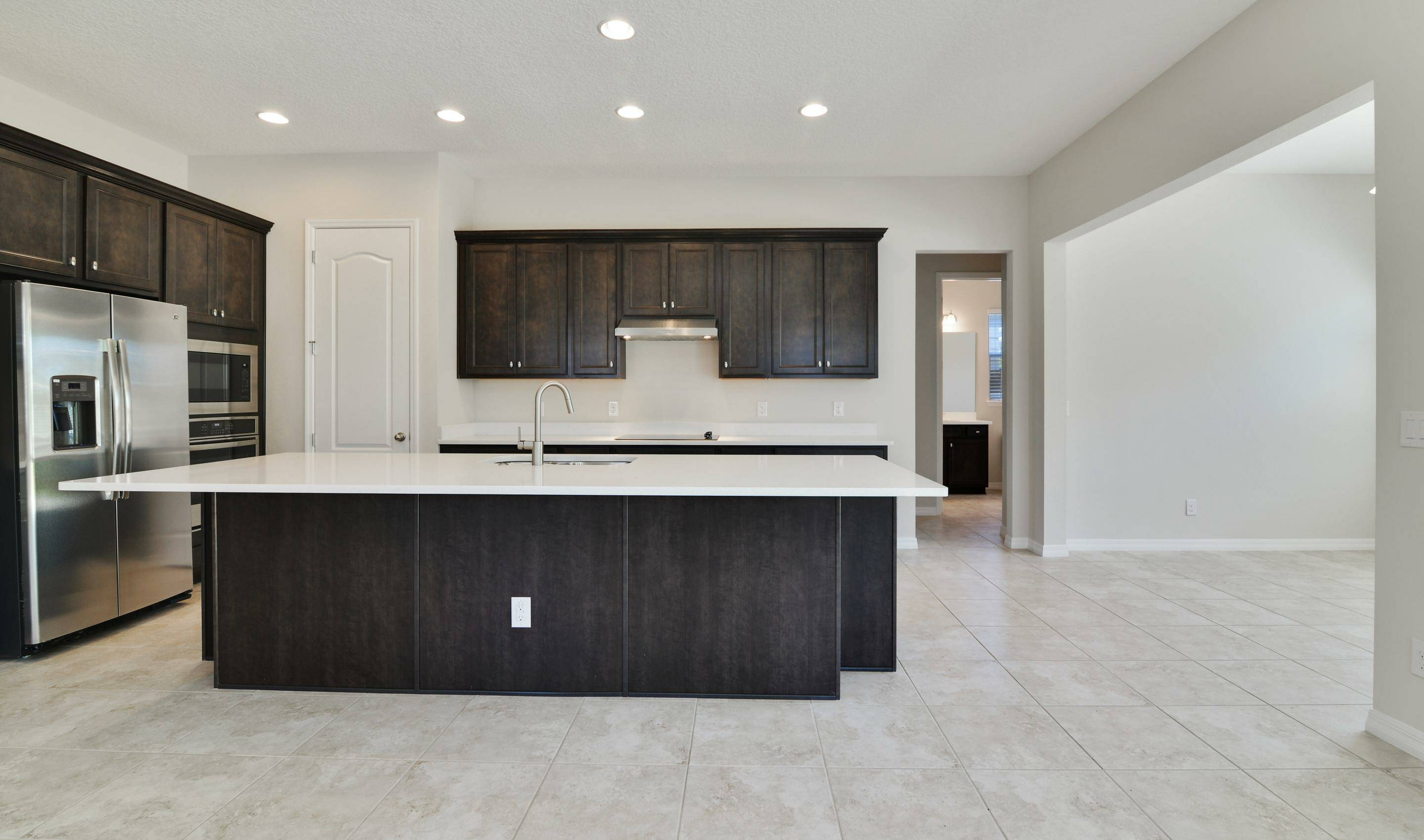 gourmet kitchen in michelson at preserve at turtle creek new homes in st cloud florida