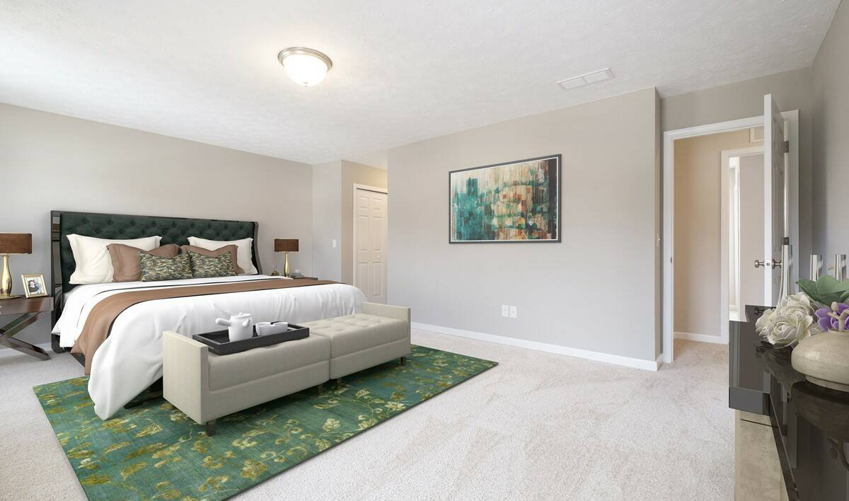 master bedroom staged with large sized bed